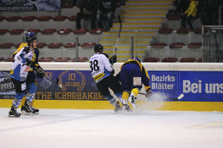 ZELL AM SEE; AUSTRIA - OCT 01: Austrian National League. A player of EKZ falls into the boards. EK Zell am See vs Linz II (Result 5-2) on October 01, 2011 in Zell am See. Stock Photo - 12279568