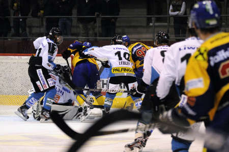 wintersport: ZELL AM SEE; AUSTRIA - OCT 01: Austrian National League. A player of EKZ (blue jersey) gets crosschecked from behind. Game EK Zell am See vs Linz II (Result 5-2) on October 01, 2011 in Zell am See.