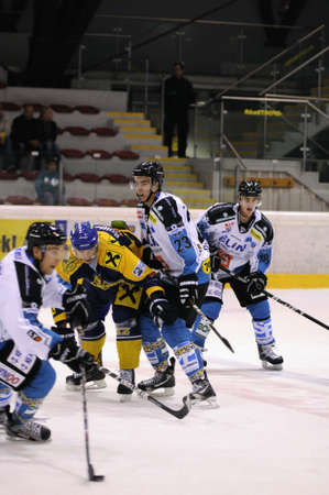 wintersport: ZELL AM SEE; AUSTRIA - OCT 01: Austrian National League. EKZ (blue jersey) and Linz fighting for each inch on the ice. Game EK Zell am See vs Linz II (Result 5-2) on October 01, 2011 in Zell am See.