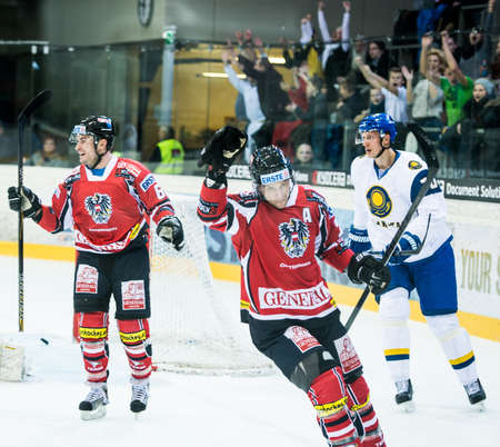 VIENNA - FEB 3: International hockey game between Austria and Kazakhstan. Daniel Welser celebrating after scoring in the first period on February 3, 2013 at Albert Schultz Halle in Vienna, Austria. Stock Photo - 17951617
