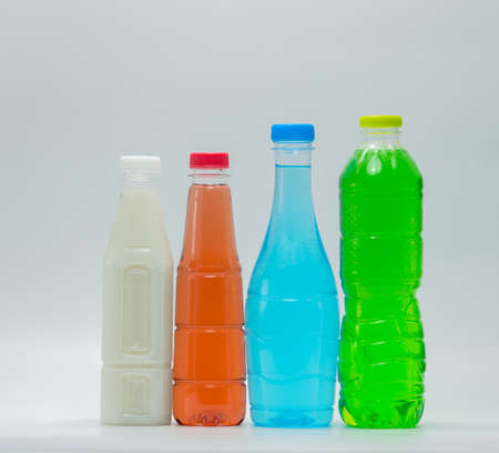 Modern design bottles of soft drink and soy milk on white background
