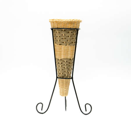 Vases are made of wicker, placed on a wrought iron base, hand made, cone shaped isolated on white background Stock Photo