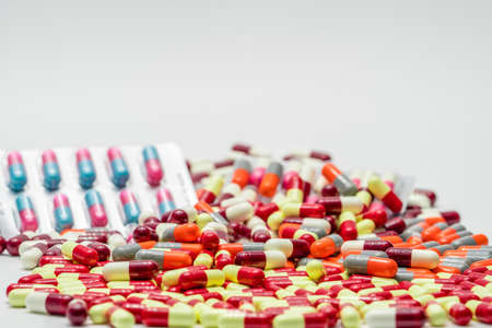 Colorful of antibiotic capsules pills on white background, drug resistance
