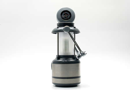 Camping lamp with black, white and grey design isolated on white background, compass, handle