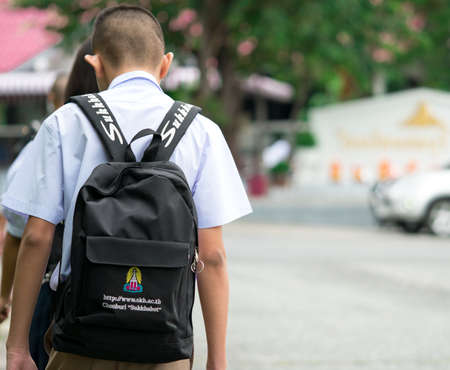 CHONBURI, THAILAND-AUGUST 3, 2017 : Thai school boy with backpack walks to school in the morning Editorial