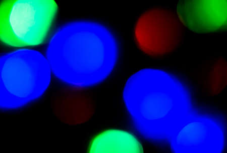 Blur red, blue and green light on dark background for Christmas concept with copy space Stock Photo