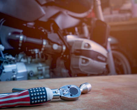 Tool on the table with single cylinder head cover of a motorcycle