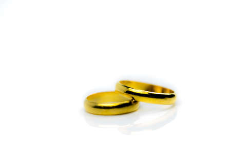 Two gold wedding ring isolated on white background with copy space, just add your own text Stock Photo