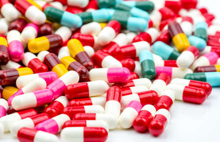 Selective focus on colorful of antibiotic capsules pills on blur background with copy space. Drug resistance concept. Antibiotics drug use with reasonable and global healthcare concept.