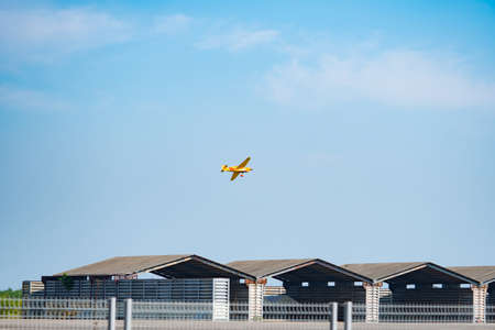 RAYONG, THAILAND-NOVEMBER 18, 2017 : Steve Temples plane no.45 Quadnickel aircraft model Cassutt III-M fly over hangar in Air Race 1 World Cup Thailand 2017 at U-Tapao Naval Air Base in Thailand