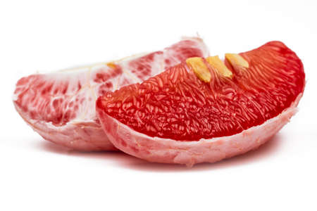 Red pomelo pulp with seeds isolated on white background. Thailand Siam ruby pomelo fruit. Natural source of vitamin C (antioxidants) and potassium. Healthy food for slow down aging