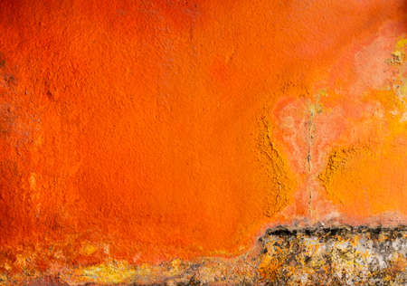 Old and dirty orange color painted on concrete wall texture background with space. Fungus on the house wall Stock Photo