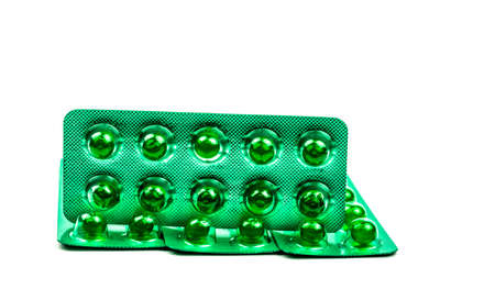 Green round soft capsule pills isolated on white background with copy space. Ayurvedic medicine for indigestion, gas and acidity. Herbal medicine made from Mentha oil and spearmint oil from India