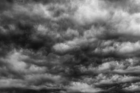 Dramatic dark sky and clouds. Cloudy sky background. Black sky before thunder storm and rain. Background for death,  sad, grieving or depression.