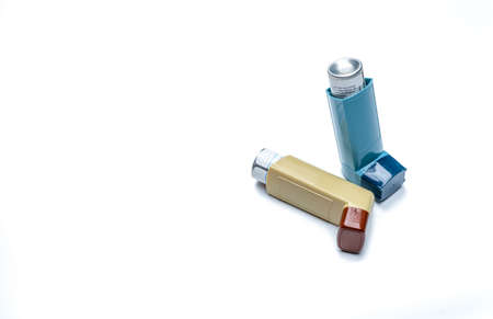 Asthma inhaler. Asthma controller, reliever equipment. Steroids and bronchodilator drug for asthma and chronic bronchitis. Budesonide aerosol CFC free for bronchial antiasthmatic. Salbutamol inhalers. Foto de archivo