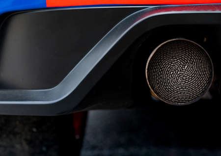 Close up detail exhaust pipe of blue SUV car. Unique pattern of car exhaust pipe. Accessories for sports car. Black soot on old exhaust pipe of gasoline engine car 版權商用圖片 - 105255174