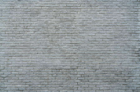 White and grey brick wall texture background with space for text. White bricks wallpaper. Home interior decoration. Architecture concept. Background for sad, hopeless and despair concept. Stock fotó