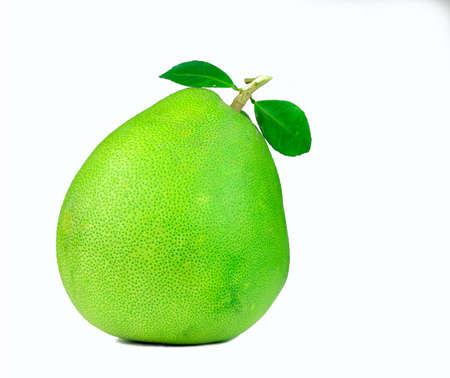 Pomelo with leaves isolated on white background. Tropical fruit. Natural source of vitamin C and potassium. Healthy food for slow down aging. Food drug interactions. Citrus fruit.  Green fruit.