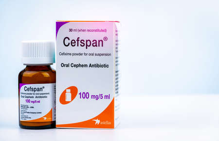 CHONBURI, THAILAND-JULY 29, 2018 : Cefspan 100 mg/5 ml. Oral Cephem Antibiotic. Cefixime powder for oral suspension 30 ml when reconstituted. Antibiotic drug in amber glass bottle and Childproof cap
