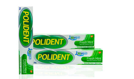 CHONBURI, THAILAND-OCTOBER 11, 2018 : Polident fresh mint denture adhesive cream in box isolated. Extra bite force and extra hold. Product of GSK. Manufactured by STAFFORD-MILLER(IRELAND) Limited.