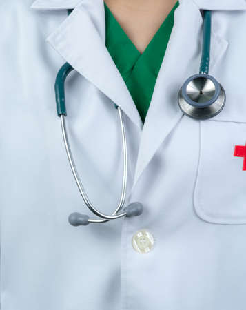 Doctor wear white uniform and green scrubs uniform inside. Doctor with stethoscope hang on neck. Healthcare professional. Patient trust concept.