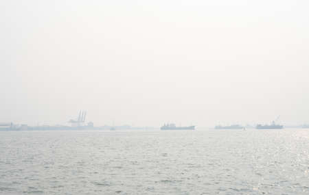Air pollution at the pier. Bad air quality filled with dust causes of respiratory diseases. Global warming from air pollution problem. Environmental problem from gas carbon monoxide and dust. PM 2.5
