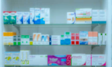 Blurred picture of medicine shelf in drug store. Pharmacy shop interiors. Pharmaceutical products in drugstore. Medical retail shop. Pharmacy in hospital. Healthcare business. Drug display shelf.