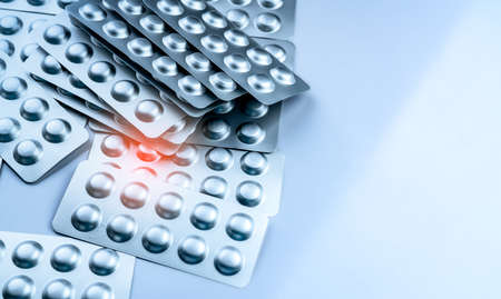 Pile of tablets pills in blister pack. Packaging in pharmaceutical industry. Pharmacy product. Drug selection to hospital. Global drug market concept. Pills management in healthcare provider. Imagens