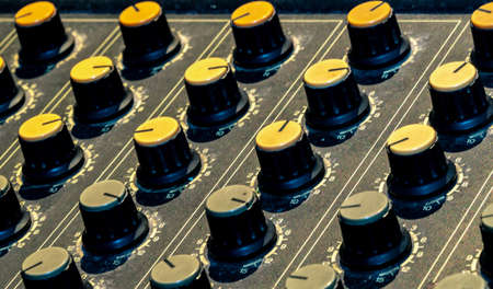 Audio sound mixer console. Sound mixing desk. Music mixer control panel in recording studio. Audio mixing console with faders and adjusting knob. Sound engineer. Sound mixer control radio broadcasting Stock Photo