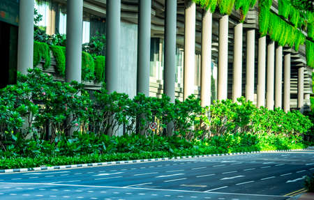 Eco friendly building with vertical garden in modern city. Green plant and tree forest and ivy on facade on sustainable building. Energy saving architecture with vertical garden. Clean environment. Stock fotó