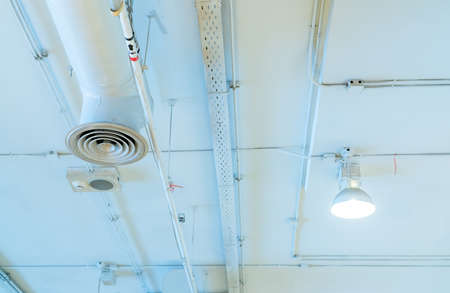 Air duct, automatic fire sprinkler safety system. Fire protection and detector. Fire sprinkler system. Building interior concept. Ceiling lamp light with opened light. Interior architecture concept.