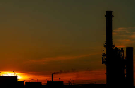 Gas turbine electrical power plant. Energy for support factory in industrial estate. Natural gas tank. Small gas power plant. Power plant using natural gas for fuel. Green energy. Dramatic sunset sky. Imagens