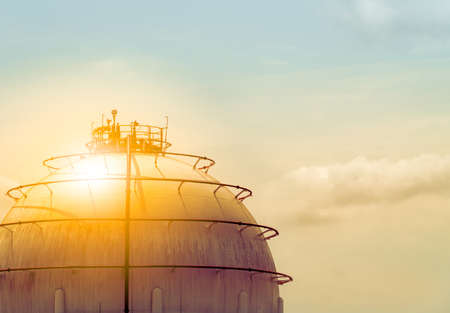 Industrial gas storage tank. LNG or liquefied natural gas storage tank. Spherical gas tank in petroleum refinery. Above-ground storage tank. Natural gas storage industry and global market consumption  Stock fotó