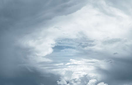 Heaven sky and white clouds. Heaven sky with light in center and dark frame. Spiritual religious background. Beautiful natural pattern of fluffy clouds. God light and planet earth concept. Bright sky.