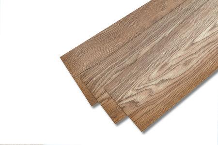 Vinyl tiles for home interior design for house renovation. New wooden pattern vinyl tile. Vinyl flooring material. Polymer vinyl sheet for new home floor. PVC material isolated on white background. Archivio Fotografico