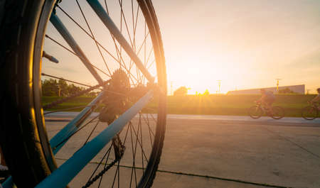 Blur photo sports man ride bicycles with speed motion on the road in the evening with sunset sky. Summer outdoor exercise for healthy and happy life. Cyclist riding mountain bike on bike lane. Team.
