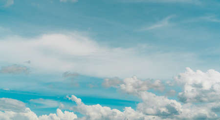 Cloudscape of white stratocumulus clouds on blue sky. Full Frame of white fluffy clouds texture background. Heaven sky with daylight. Beauty in nature. Summer sky. Pure white clouds. Freedom concept. Stock fotó