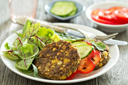Vegan chickpeas burgers with salad and vegetables photo