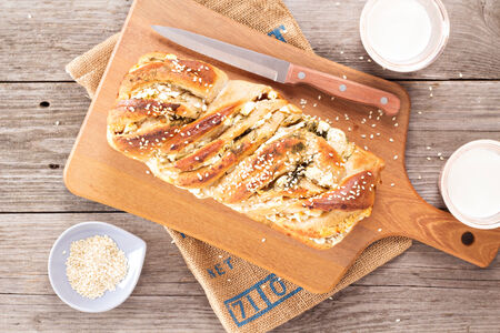 Bread with herbs and cheese on a cutting board Banco de Imagens