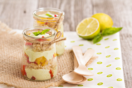 Verrine with quinoa, bell pepper and avocado cream photo