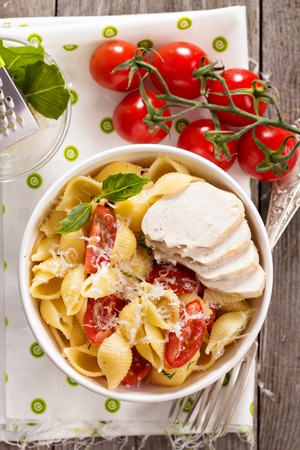 Pasta with cheese and cherry tomatoes in a bowl Banco de Imagens