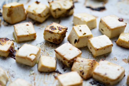 Baked marinated tofu with herbs and spices Stock fotó