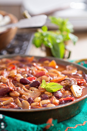 red chili pepper: Vegan chili with beans, mushrooms, and vegetables