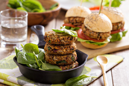 Vegan burgers with  beans and vegetables served with spinach photo