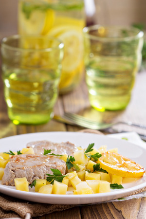 Pork medallions with patato, zucchini, apples and lemons