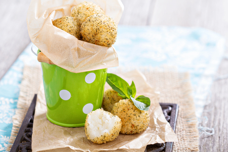 Vegan risotto arancini fried with herbs and breadcrumbs