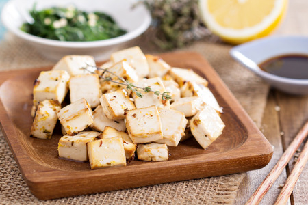 tofu: Baked marinated tofu with herbs and spices Stock Photo
