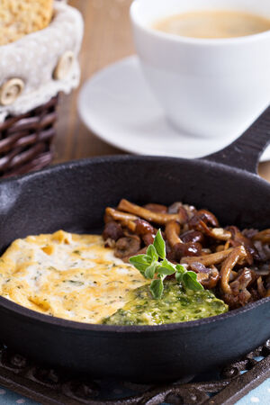 Vegan tofu omelet served with mushrooms and pesto photo