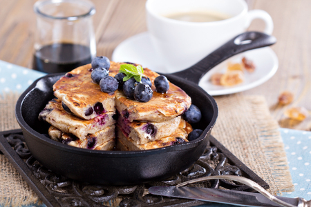 Eggless pancakes with banana and blueberries in a small pan photo