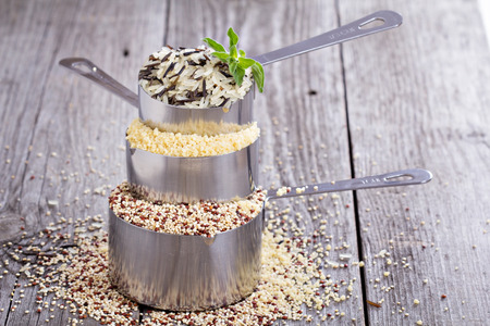 measuring cup: Variety of grains in stacked measuring cups Stock Photo